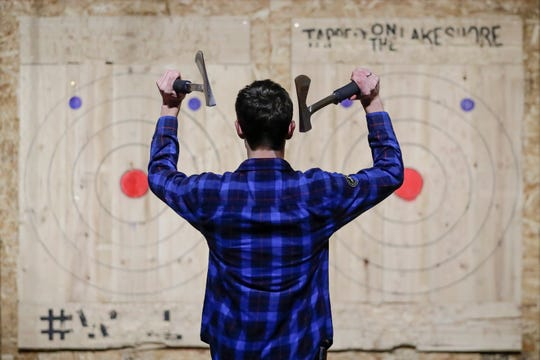 Ethan Markowski throws double axes during league night at Tapped on the Lakeshore Tuesday, April 9, 2019, in Two Rivers, Wis. Joshua Clark/USA TODAY NETWORK-Wisconsin