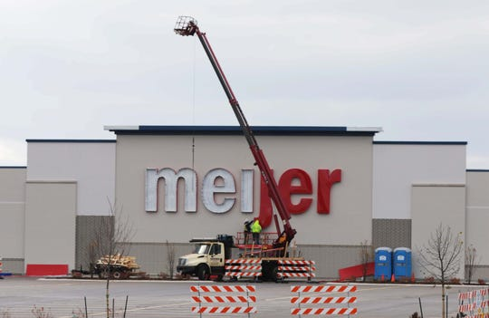 Manitowoc's new Meijer complex gets its signs installed, Tuesday, October 29, 2019, in Manitowoc, Wis.