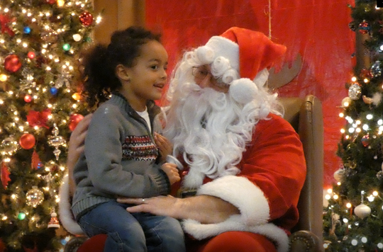 Santa gave roughly 100 kids a gift Thursday night at the annual Friendly House Christmas party sponsored by the Mansfield Kiwanis Club. Almondo Grose tells Santa what he wanted for Christmas.