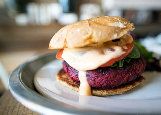 The Beet Walnut Burger, made with red beets, crushed walnuts, red onion, carrot, gluten-free oats, dried tomatoes, garlic, tamari, pink salt, herbs and spices and topped with sriracha aioli, is available at City Silo Table + Pantry.