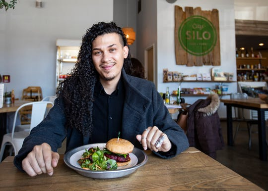 Memphis vegan food blogger Jeremie Serrano sits at City Silo Table + Pantry in Memphis on Dec. 18. Serrano is vegan and loves not only to cook, but to eat out. He chronicles his dining and grocery shopping adventures on his website and YouTube channel, La Comida de Jeremie.