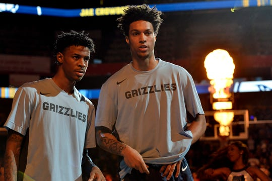 Memphis Grizzlies guard Ja Morant, left, and forward Brandon Clarke stand on the court during player introductions before an NBA basketball game against the Houston Rockets Monday, Nov. 4, 2019, in Memphis, Tenn. (AP Photo/Brandon Dill)