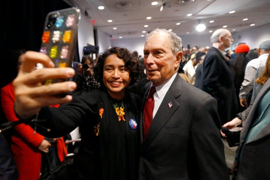 Silvia Alvarez, a former deputy press secretary for the mayor of New York and current Memphis resident, takes a selfie with Democratic presidential candidate Michael Bloomberg at the Benjamin L. Hooks Central Library on Thursday, Dec. 19, 2019.