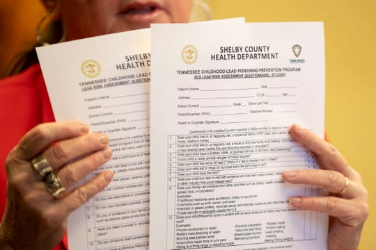 Shelby County Health Department Director Alisa Haushalter holds up lead risk assessment questionnaires while talking with the media Thursday, Dec. 19, 2019, at the Shelby County Health Department in Memphis.