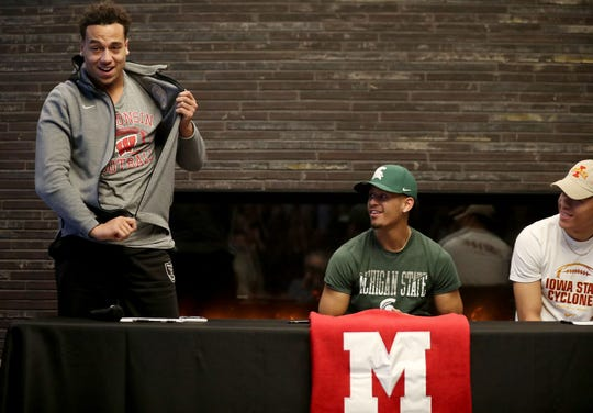 Minnehaha Academy football players Kaden Johnson, from left, Terry Lockett Jr., Craig McDonald made their college football plans official and signed letters of intent Wednesday.  Johnson is headed to the University of Wisconsin, Lockett to Michigan State and McDonald to Iowa State.