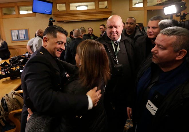 Milwaukee Police Chief Alfonso Morales  is greeted by supporters after he received a four-year contract extension Wednesday night on a 4-2 vote from the Milwaukee Fire and Police Commission at City Hall.