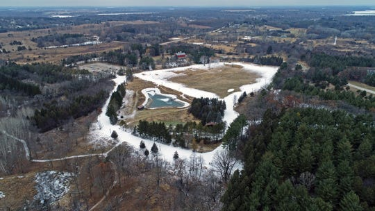 A drone provides an aerial view of man-made snow along ski trails at Lapham Peak in Delafield on Tuesday, Dec. 17, 2019.