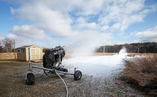 Two snow guns create snow along a ski trail at Lapham Peak in Delafield on Tuesday, Dec. 10, 2019.