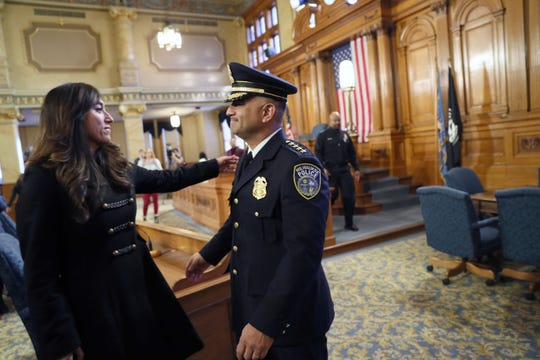 Milwaukee Police Chief Alfonso Morales is embraced by his wife, Julissa, after he was sworn in.