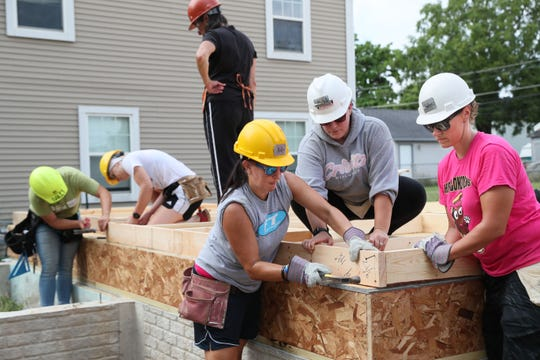 In August 2019, more than 100 women from across the area joined together in Milwaukee's Midtown neighborhood to work on homes for Milwaukee Habitat for Humanity. Here, from left, Holly Tamm of Franklin, Michelle Bauer of West Bend and Katie Gierach of Menomonee Falls work on framing for exterior walls at a home site.