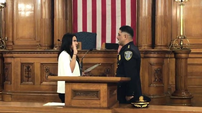 Milwaukee Police Chief Alfonso Morales is sworn in for a four-year term by Griselda Aldrete, executive director of the Fire and Police Commission.