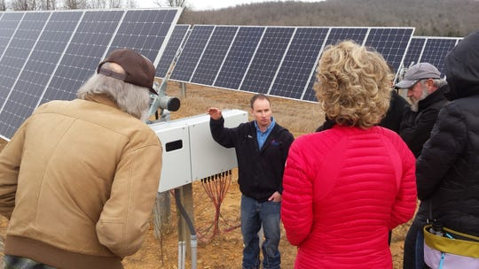 North Arkansas Electric Coperative systems engineer Kevin Reese explains the function of an inverter in solar power systems to members of the Twin Lakes Sustainability Volunteers on Dec. 13.