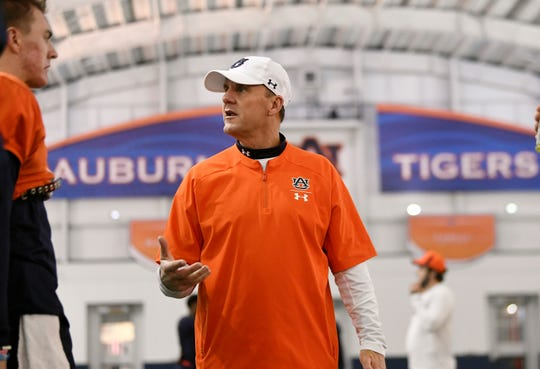 Auburn offensive coordinator Chad Morris speaks to quarterback Bo Nix at practice on Wednesday, Dec. 18, 2019 in Auburn, Ala.