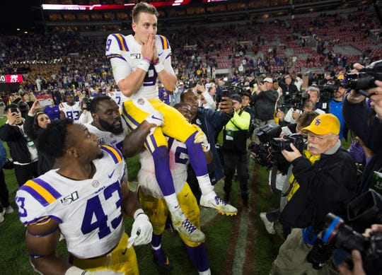 LSU quarterback Joe Burrow (9) is hoisted up by his teammates after the game at Bryant-Denny Stadium in Tuscaloosa, Ala., on Saturday, Nov. 9, 2019. LSU defeated Alabama 46-41.