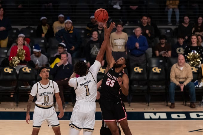Ball State redshirt senior forward Tahjai Teague goes for the ball at the tip during the Cardinals' game against Georgia Tech.