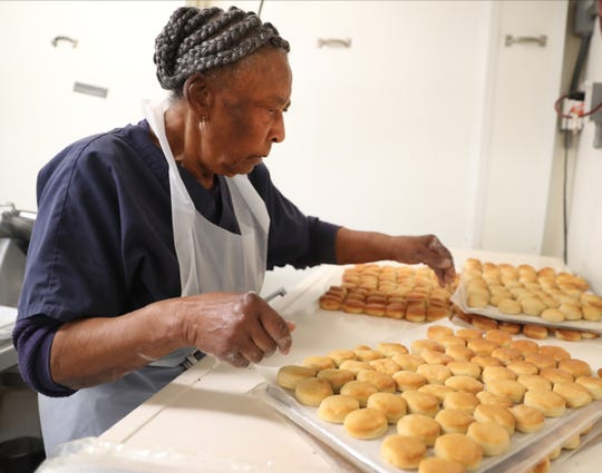Louise Smith, moves the freshly made biscuits to get into the freezer at the G & W Hamery, in Murfreesboro, on Thursday Dec. 19, 2019.