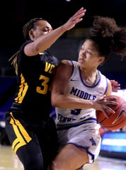 MTSU guard Kiya Turner (5) drives to the basket against VCU's Nyra Williams.