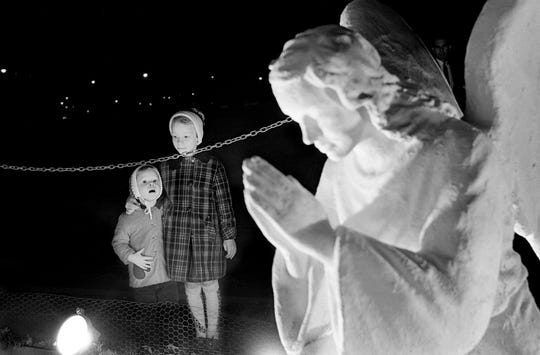 Emily Thrasher, 3, and her sister Amy, 7, watch in wide-eyed wonder as Centennial Park's Nativity scene is lighted for the holiday season Nov. 23, 1966. They are the daughters of Mr. and Mrs. Byron Thrasher of the Hillsboro Garden Apartments.