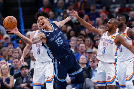 Memphis Grizzlies forward Brandon Clarke (15) reaches for a loose ball in front of Oklahoma City Thunder guard Chris Paul (3) in the first half Wednesday, Dec. 18, 2019, in Oklahoma City.