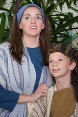 Amahl's mother (Lauryn Kay) and Amahl (Jake Milton) are about to learn of a child who will change their life.