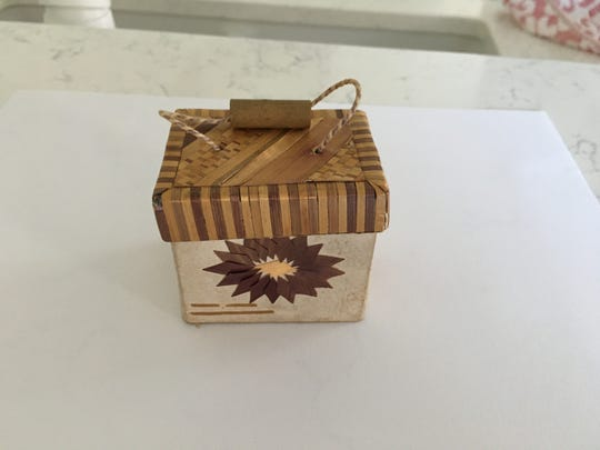 A wooden box ornament belonging to Molly Kiss, from her mother.