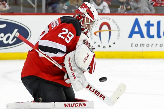 New Jersey Devils goaltender Mackenzie Blackwood makes a save during the first period of the team's NHL hockey game against the Anaheim Ducks, Wednesday, Dec. 18, 2019, in Newark, N.J.