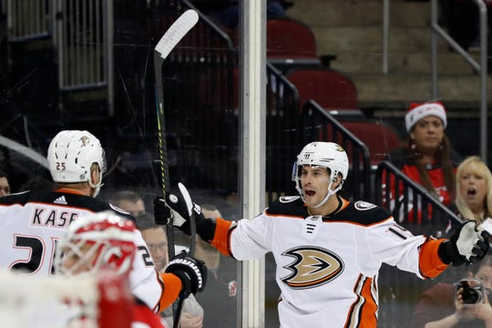 Anaheim Ducks center and former Devil Adam Henrique (14) celebrates with right wing Ondrej Kase (25) after scoring a goal against the New Jersey Devils during the first period of an NHL hockey game Wednesday, Dec. 18, 2019, in Newark, N.J.