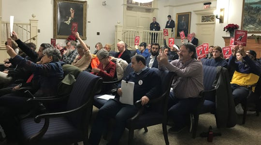 Rutgers University faculty union members and students brought several demands to the Board of Governors meeting on Dec. 17, 2019, including higher pay and divestment from fossil fuel industry.