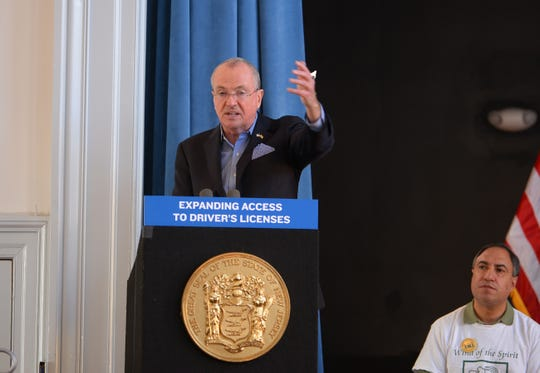 Gov. Phil Murphy speaks before signing legislation allowing undocumented immigrants to obtain a state driver's license at the Snyder Academy in Elizabeth on 12/18/19.