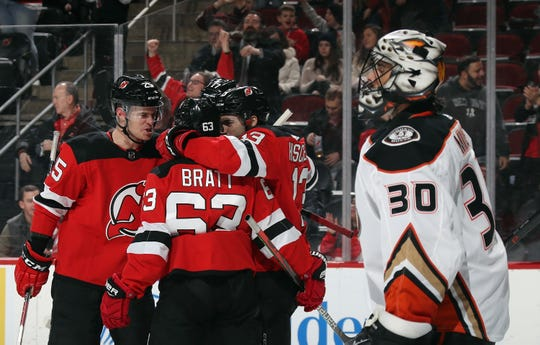 The New Jersey Devils celebrate a goal by Nico Hischier #13 against Ryan Miller #30 of the Anaheim Ducks at 1:28 of the second period at the Prudential Center on December 18, 2019 in Newark, New Jersey.