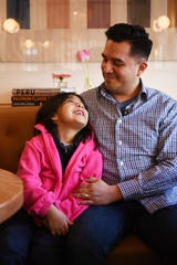 Owner Juan Placencia and his daughter pose for a photo at Somos restaurant in North Arlington