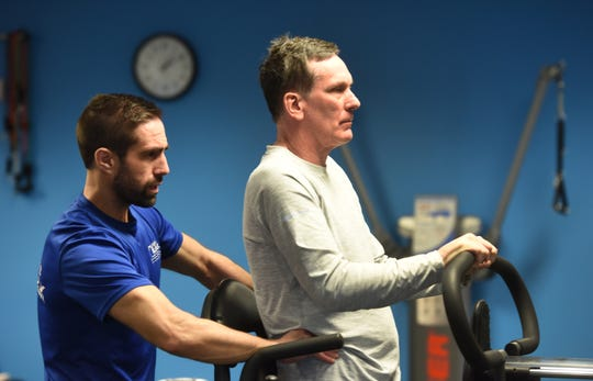 Push to Walk trainer Matt Lasky helps client Jim Slevin.