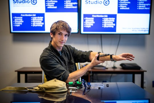Western New Mexico University biology student Nicolas Farley, who interned with the NASA Earth Science Division this summer, models an exo-suit he is inventing.