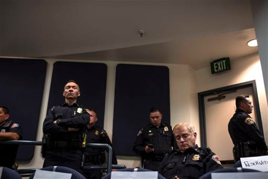 Albuquerque police chief Gorden Eden sits in audience during a city council meeting in Albuquerque, N.M., Thursday, May 8, 2014.