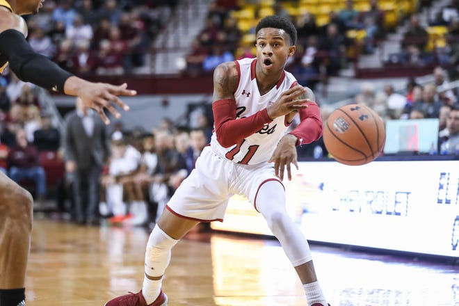 NMSU junior guard Evan Gilyard (11) passes as the New Mexico State Aggies faces off against the Arkansas-Pine Bluff Golden Lions at the Pan American Center in Las Cruces on Wednesday, Dec. 18, 2019.