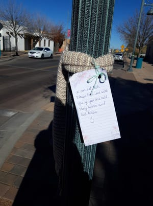 An anonymous stranger is tying scarves around poles in downtown Las Cruces for people to find and pay it forward themselves.