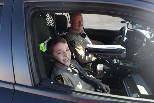 Sammy Fodge (left) and Eddy County Sheriff's Sgt. Ray Williams get ready to conduct a traffic stop Thursday at the Bulldog Bowl in Artesia.