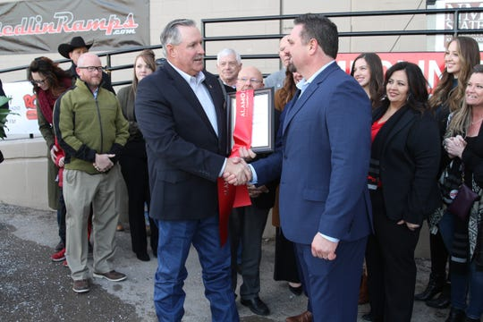 Alamogordo Chamber of Commerce Board Chairman Randal Rabon, left, shakes hands with CEO Mark Medlin at the official grand opening of Medlin Ramps at 1900 Highway 54 South in Alamogordo on Wednesday evening.