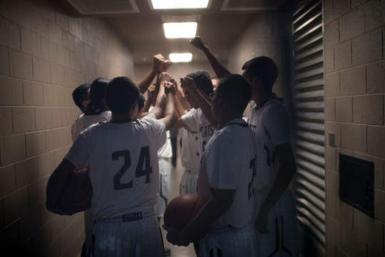 Players on the Chinle High School boys basketball team get ready for a game against Holbrook High School at the Wildcat Den stadium on Dec. 13, 2016.