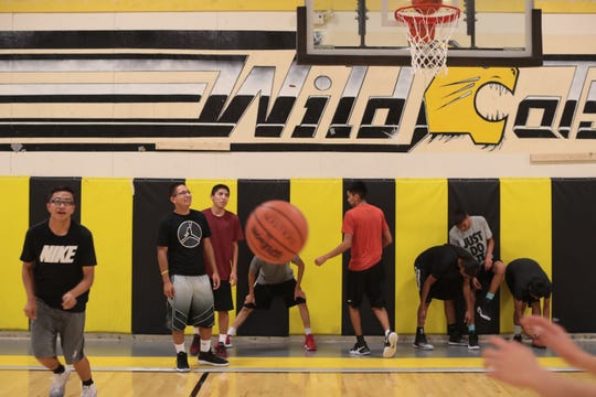 Players on the Chinle High School varsity basketball team at practice on Dec. 12, 2016.
