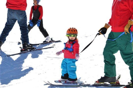 This little one gets a lesson in skiing at Ski Cloudcroft, New Mexico all geared up and ready to hit the Bunny Slopes.
