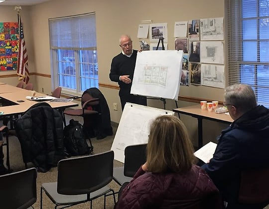 Northville architect Greg Presley explains a proposed plan with the Downtown Development Authority economic committee.