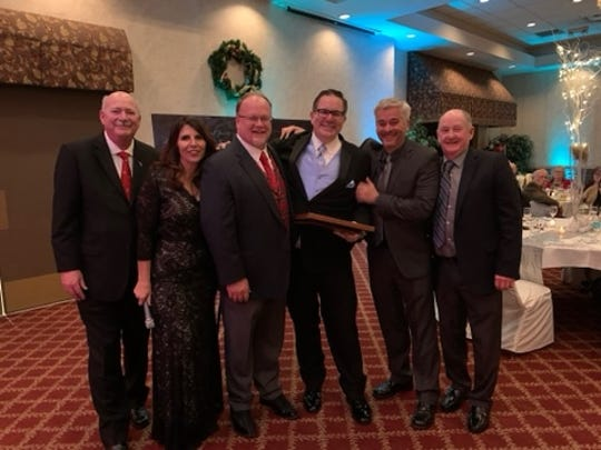 Todd Hibberd, center, was honored by the Huron Valley Chamber of Commerce as the 2019 Citizen of the Year. He is surrounded by (from left) Ron Fowkes, Joell Beether, Jim Runestad, Rick Kirchner and Bob Hoffman.