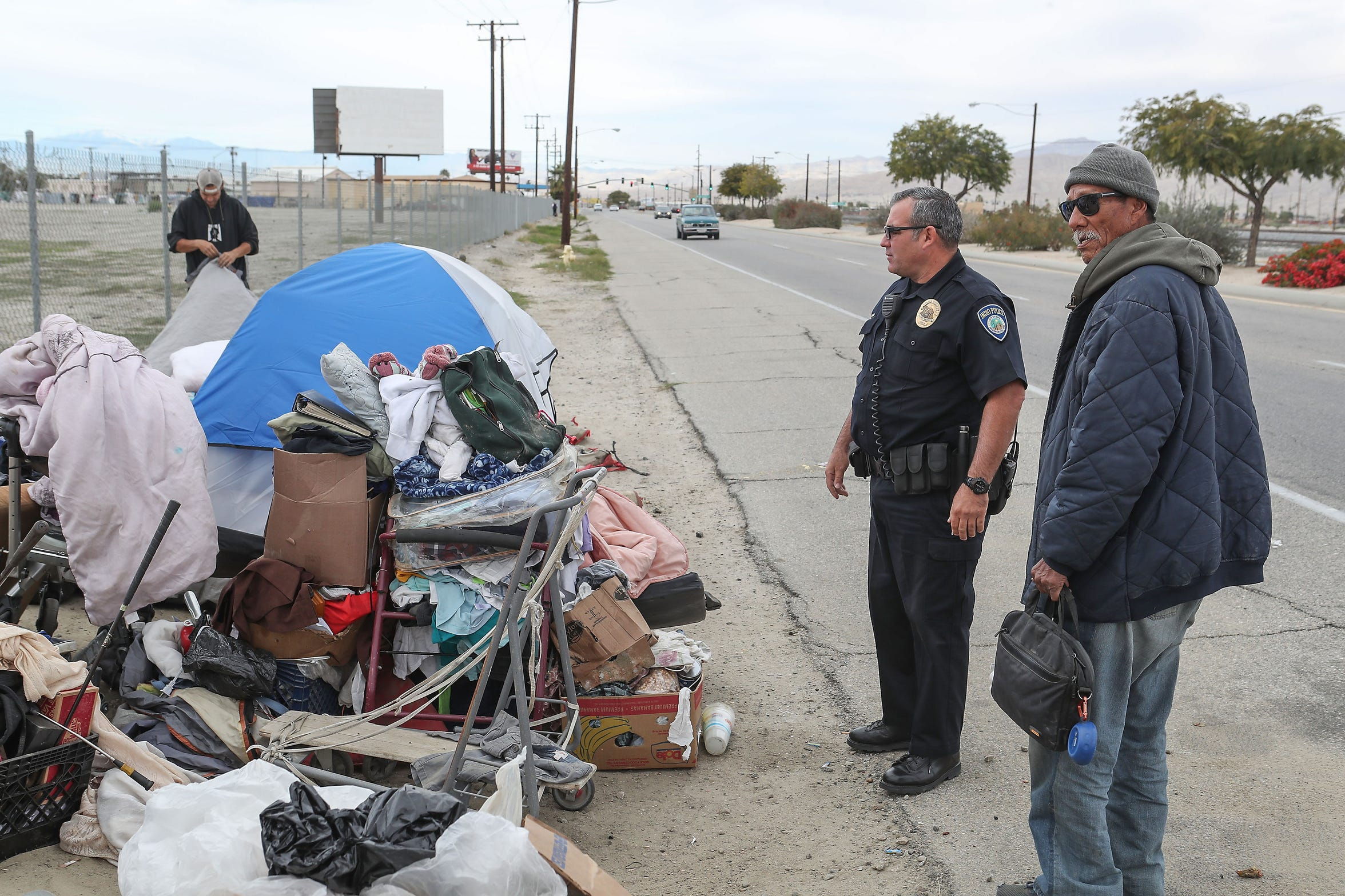 Indio Police Officer Brandon Haworth responds to a call of homeless encampments on the side of Highway 111, December 18, 2019.