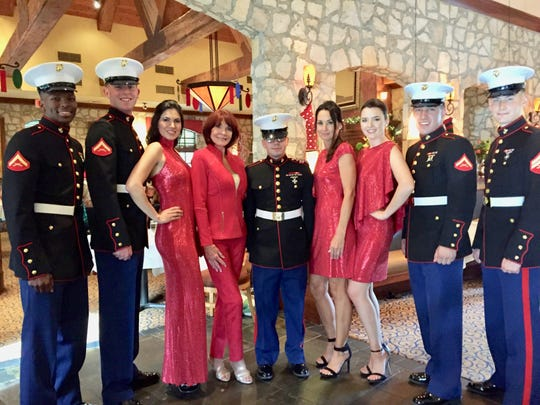 LCPL Tishawn Peagler, LCPL Willis Geoffrey, CPL Brandon Johnson, LCPL Joshua Miller and CPL Jeremiah Cloius enjoy the spotlight with Grayse models Ahmec Amid, Pat Sanner, Tracy Meyer and Emily Stanber