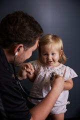 Elevated Health physician Dr. Matthew Abinante examines a child at the Direct Primary Care practice.