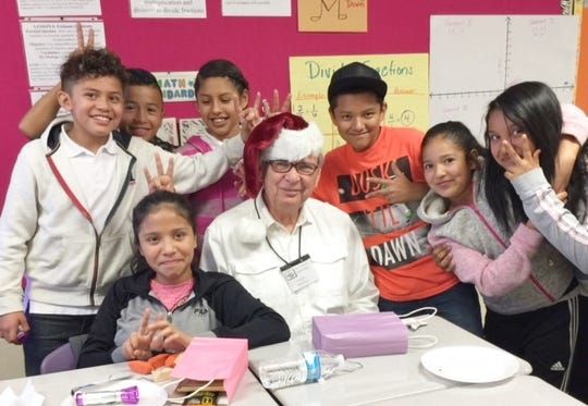 Horst Engel and the kids he works with celebrate the holidays.