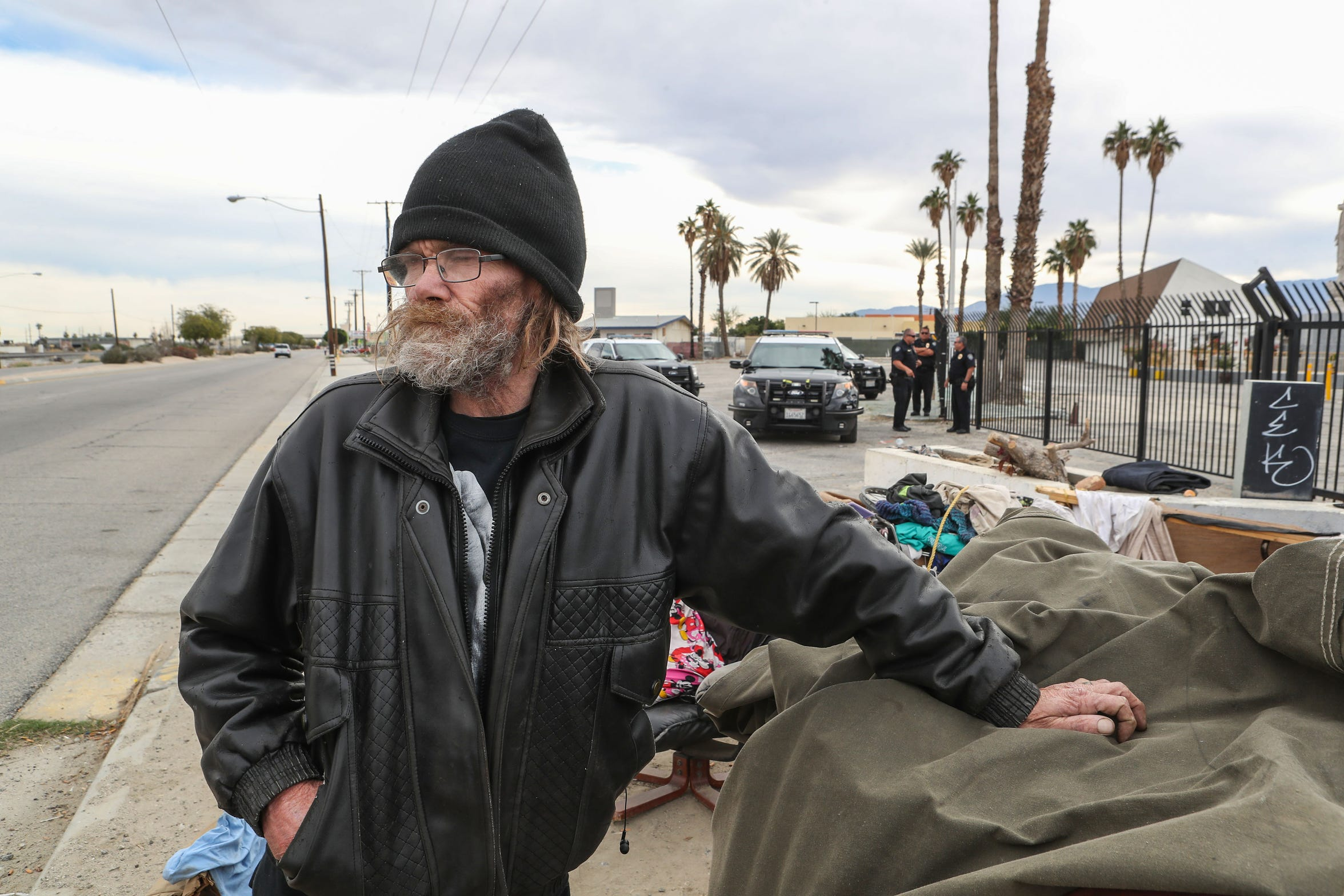 Lauren Strait talks about life living on the streets of Indio shortly after the Indio Police informed him he would need to move his encampment off the side of Highway 111 in Indio, December 18, 2019.