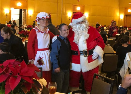 Santa and Mrs. Claus wish a merry Christmas to a Pegasus client.