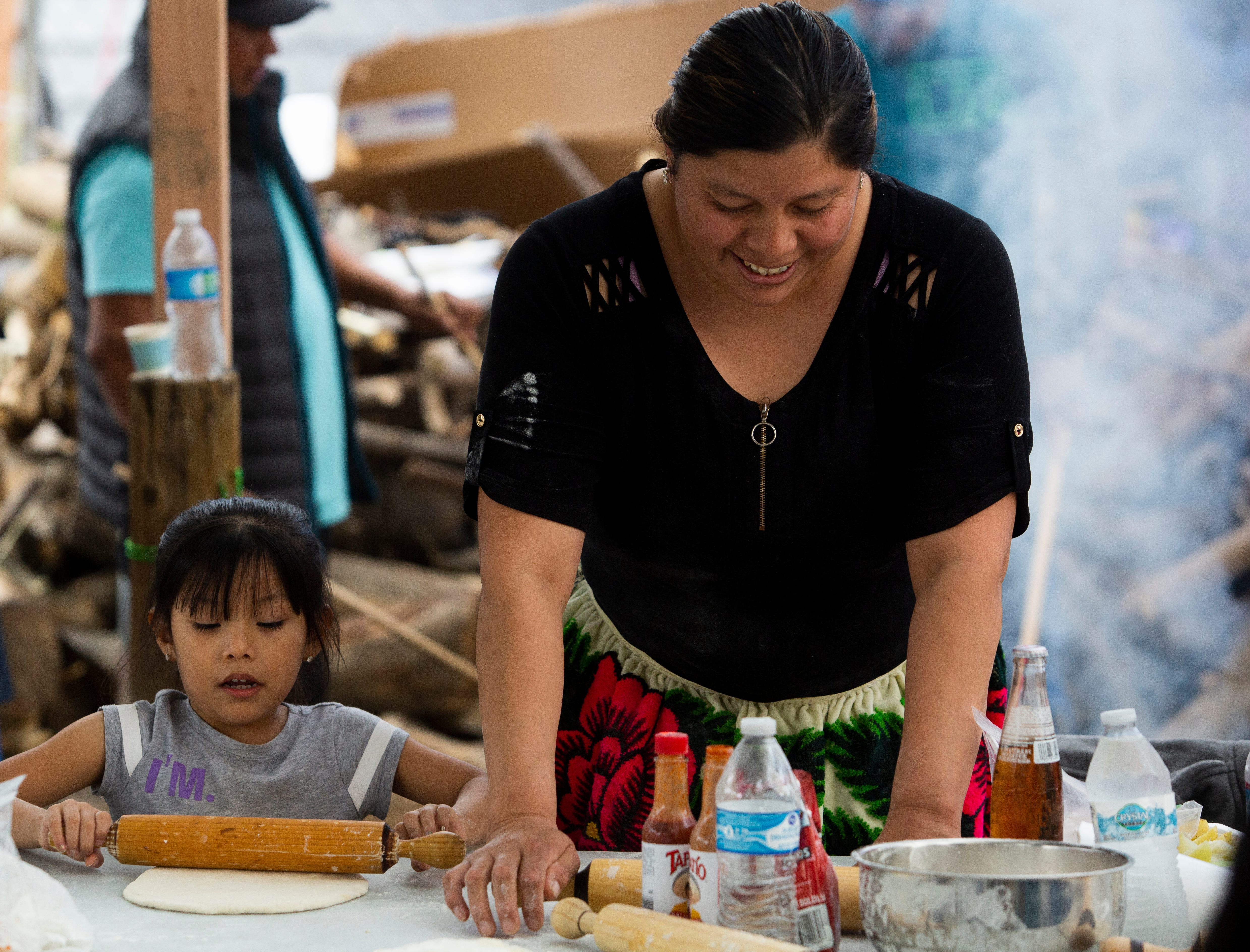 """Analia Alonso and her mother, Eva Basilio, prepare dough for """"buñuelos,"""" a Mexican holiday pastry, to prepare for the Virgin of Guadalupe festivities in Thermal, Calif."""